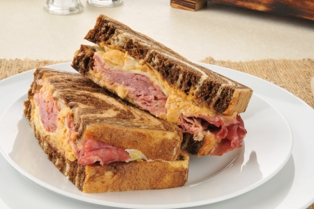 A reuben sandwich on marbled rye bread