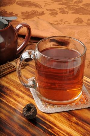 Pu-erh tea molded into an nest with a teapot Banco de Imagens - 15375218