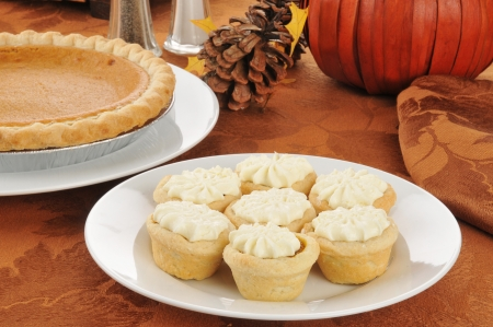 A plate of pumpkin tarts on a Halloween or Thanksgiving table photo