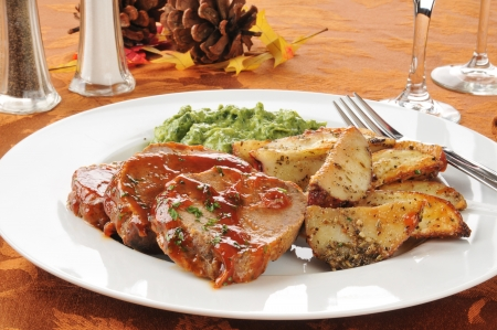 meatloaf: Meatloaf and potato dinner on a festive holiday table setting Stock Photo