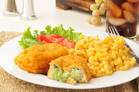 Breaded stuffed chicken with macaroni and cheese photo