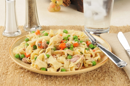 tunafish: Tuna noodle casserole on a plate with peas and carrots