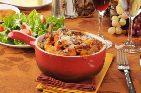Rigatoni in marinara sauce with italian sausage, meatballs, and pepperoni and a green salad photo