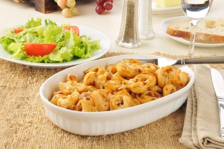 Tortellini in a casserole dish with tomato pesto