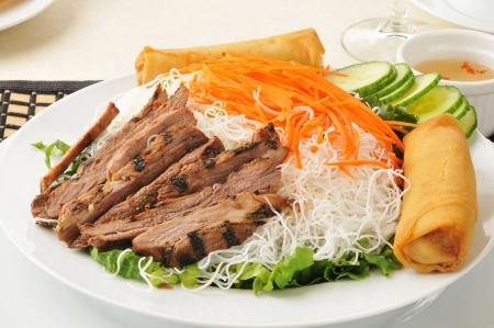 A Vietnamese salad with beer, cucumbers, greens and rice noodles Stock Photo - 15869017