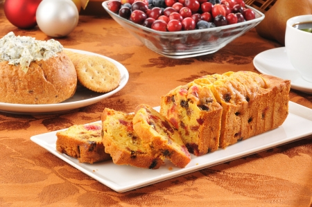A delicious Christmas fruit cake with dip and crackers Standard-Bild