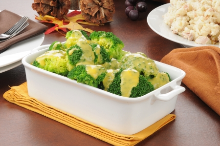 tunafish: Broccoli with cheese sauce and a bowl of tuna casserole