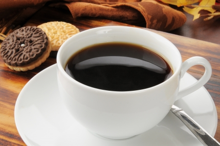 duplex: A cup of black coffee with duplex sandwich cookies