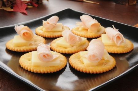 horozontal: Snack crackers with swiss cheese and smoked turkey or ham