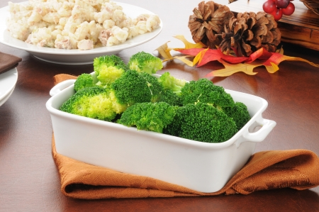 A serving dish of fresh cooked broccoli with tuna casserole