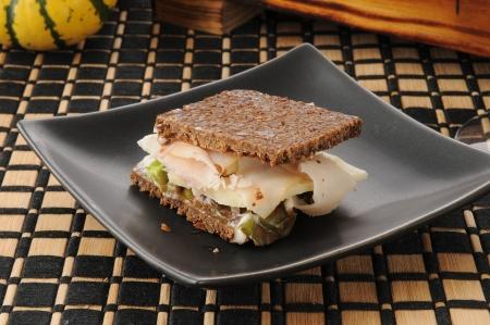 pumpernickel: A ham and swiss on pumpernickel mini sandwich as an appetizer