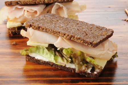 Smoked turkey or ham with swiss cheese on pumpernickel bread Stock Photo