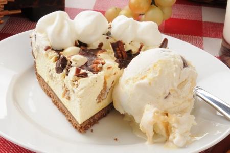 A slice of turtle pie with vanilla ice cream closeup Archivio Fotografico