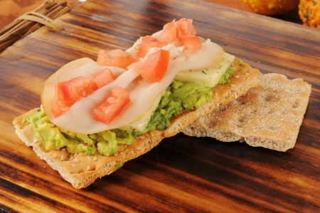 Crispbread appetizers iwth avocado, dill cheese, smoked turkey or ham and tomato