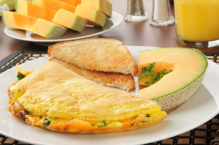 Closeup of a western omelet with cantaloupe and toast Banco de Imagens