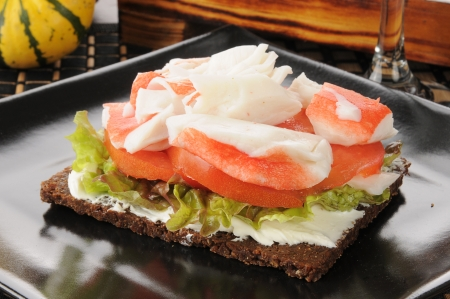 topped: pumpernickel bread topped with mayonnaise, lettuce, tomato and crab