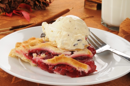 ice crust: a slice of hot cherry pie with a scoop of chocolate chip ice cream Stock Photo