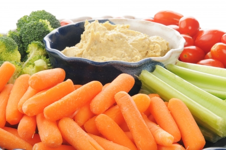 Closeup of a vegetable platter with Greek style hummus