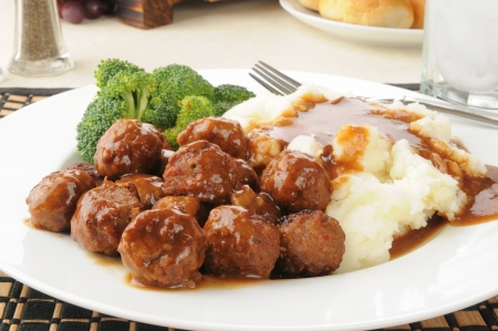 gravy: Closeup of swedish meatballs with gravy