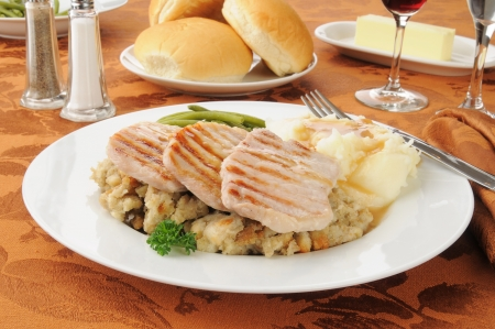 horozontal: Grilled pork chops with mashed potatoes and herb dressing