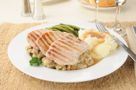 horozontal: Grilled pork chops with mashed potatoes and gravy Stock Photo