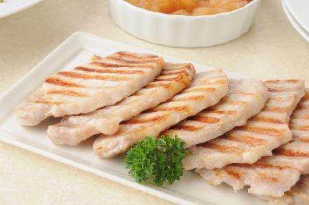 A platter of thin sliced boneless pork chops Banco de Imagens