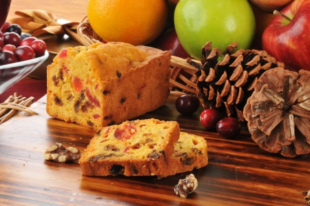Sliced Christmas fruitcake on a cutting board photo