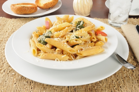 Rigatoni with romano and parmesan cheese, spinach and tomatoes photo