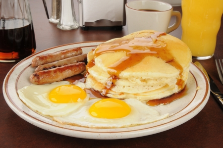 hotcakes: A sausage and egg breakfast with pancakes