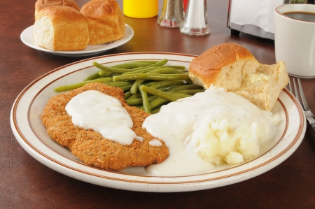 breaded: Chicken fried steak with mashed potatoes and country gravy Stock Photo