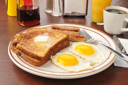 Breakfast of french toast with fried eggs photo