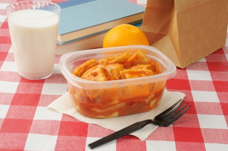 Ravioli in a school sack lunch with a glass of milk Stock Photo - 16987117