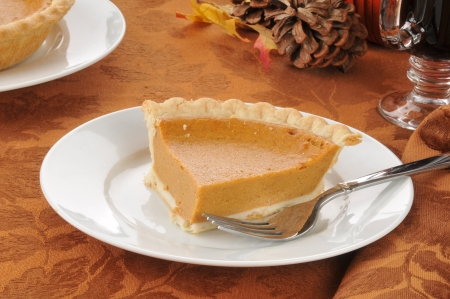 a slice of pumpkin pie with hot spice wine photo