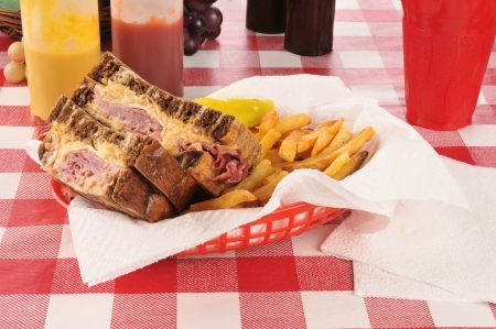 reuben: A reuben sandwich in a basket with french fries