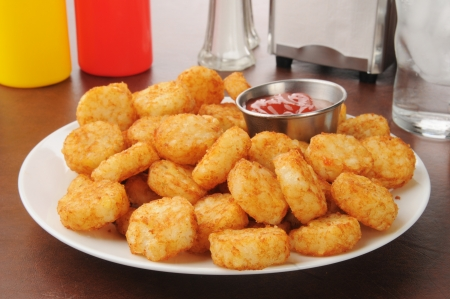 catsup: Hash brown potato cakes with catsup