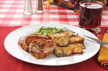 meatloaf: Sliced meatloaf with potato wedges and creamed spinach