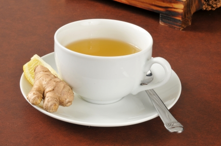 cold remedy: A cup of hot green tea with lemon and ginger