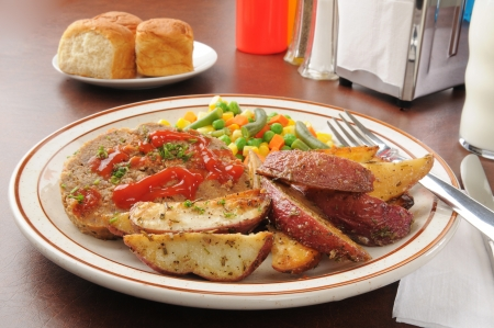 Meatloaf with potato wedges and mixed vegetables Stock Photo - 17385156