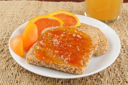 Organic apricot jam on sprouted grain toast