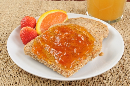 sprouted: Apricot jam on sprouted grain toast with strawberries and oranges