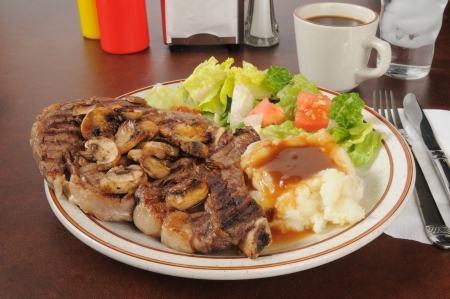 A juicy grilled rib steak with potatoes and salad Stock Photo - 18049782