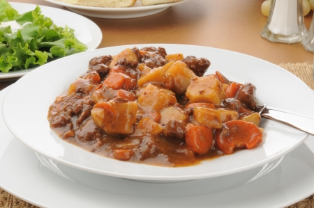 A bowl of hearty beef stew, closeup