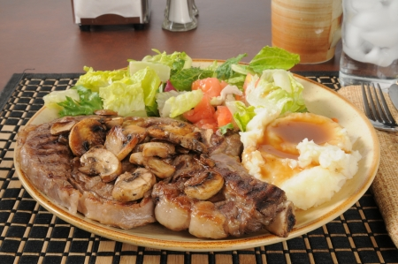 Grilled rib steak wtih mashed potatoes and gravy and green salad Stock Photo - 18209234