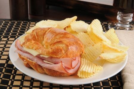 A ham and swiss cheese croissant sandwich Фото со стока