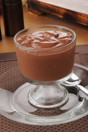A glass dessert cup of rich chocolate pudding