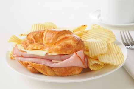 A ham and swiss cheese sandwich on a croissant Фото со стока - 18365720