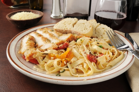 Chicken scaloppini with fettuccini and roasted tomato