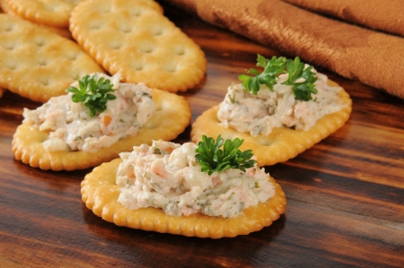 Smoked salmon spread on whole wheat crackers