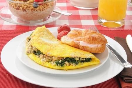 Spinach and feta cheese omelet with a croissant with strawberry cream cheese photo