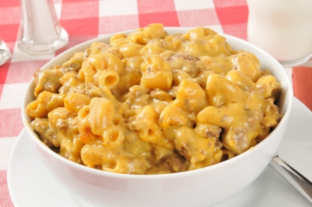 Closeup of a bowl of macaroni and beef casserole with cheese sauce photo